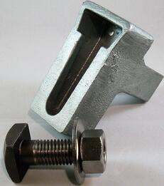 Wedge inserts and askew head bolts work simultaneously to prevent movement in relieving angles, shelf angles and lintels